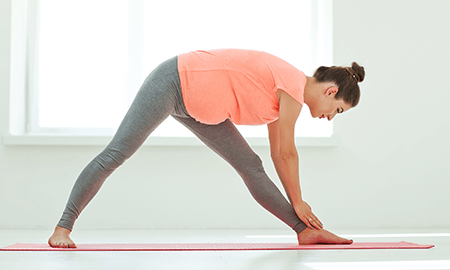 Header Image Pregnant Woman Doing Yoga